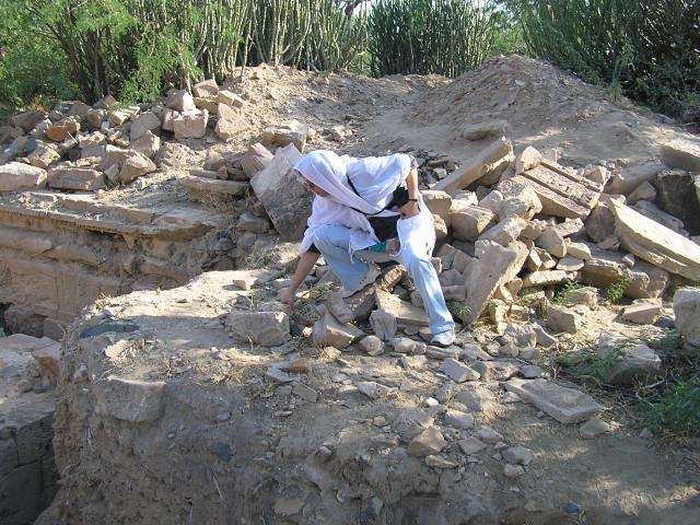 Me busy examining the stone pieces