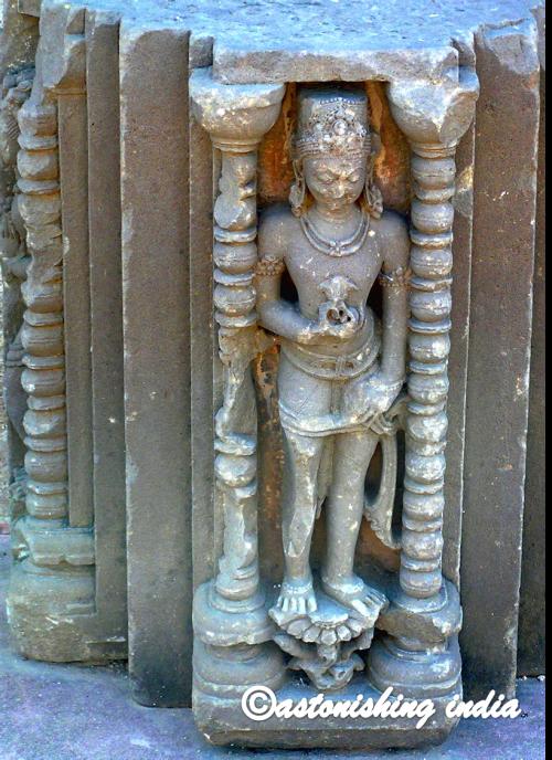 goddess carved in stone panel