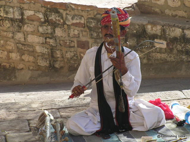 A street artist with local stringed instrument