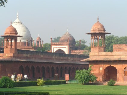 tombs of other queens of Shah Jahan at the entrance of the Taj in red sandstone