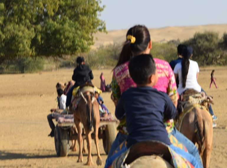 Off to camel safari on our camels and Camel cart