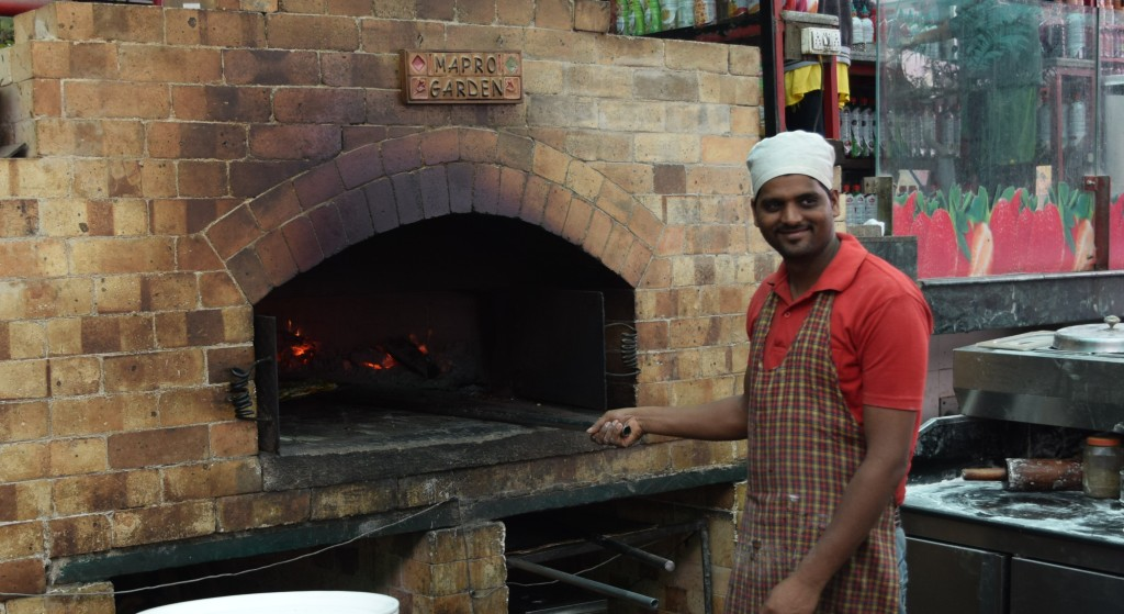 Santosh...head cook at pizza oven