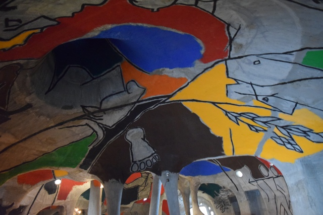 Paintings by M F Hussain on walls and ceiling of the gallery