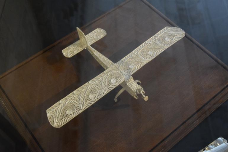 Filigree silver aircraft