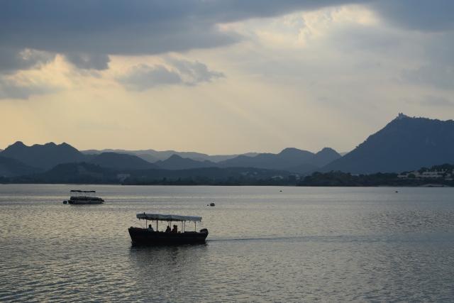 Boating on the serene blue Lake Pichola