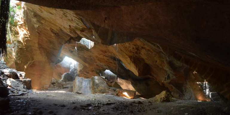 Sunlight filtering in through many gaps in the roof of caves