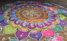 kolam of coloured sand
