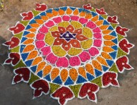 kolam made from dyed radish, bottle gourd and beetroot