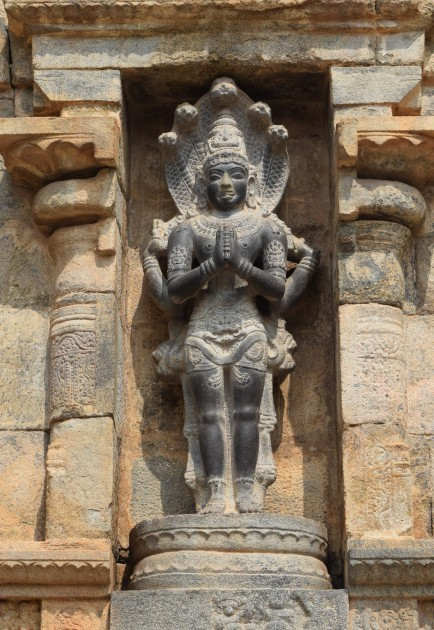 One of the niches on outer wall with idol of Snake God