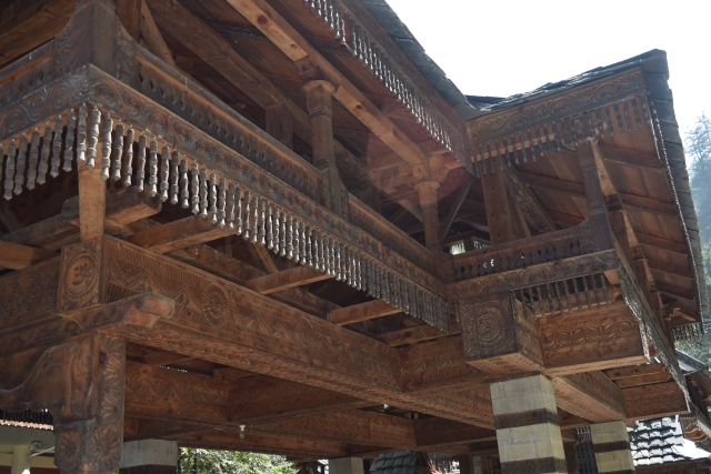 Overhanging wooden balconies supported by wood rafters