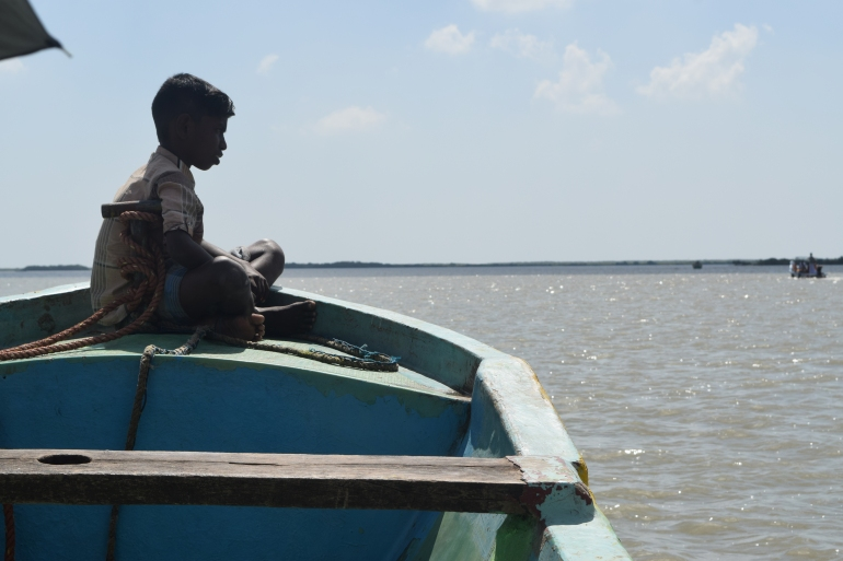 Younger boy of the boatman