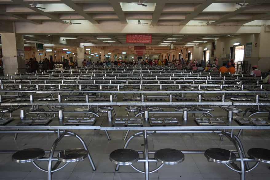 Rows of dining tables for the devotees seeking prasad meal