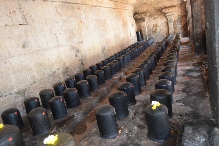 Shivalingam in pillared corridors