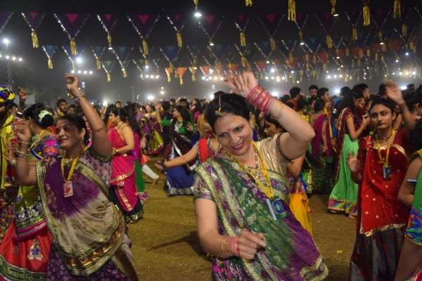 Men women of all age dance to the devotional songs