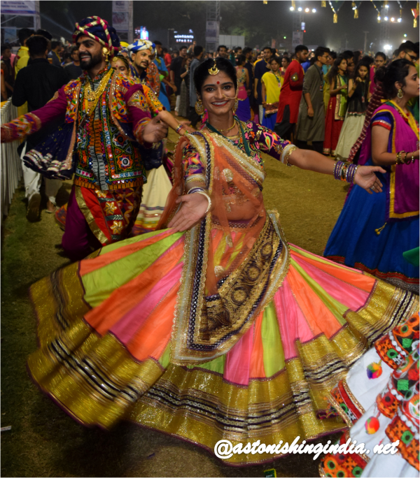 A woman swirling away to beats at United Way Garba