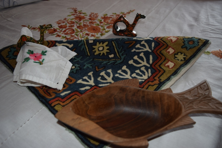 Some of the things I still preserve.. papier mache napkin-holders, cushions, wood bowl, bed-cover