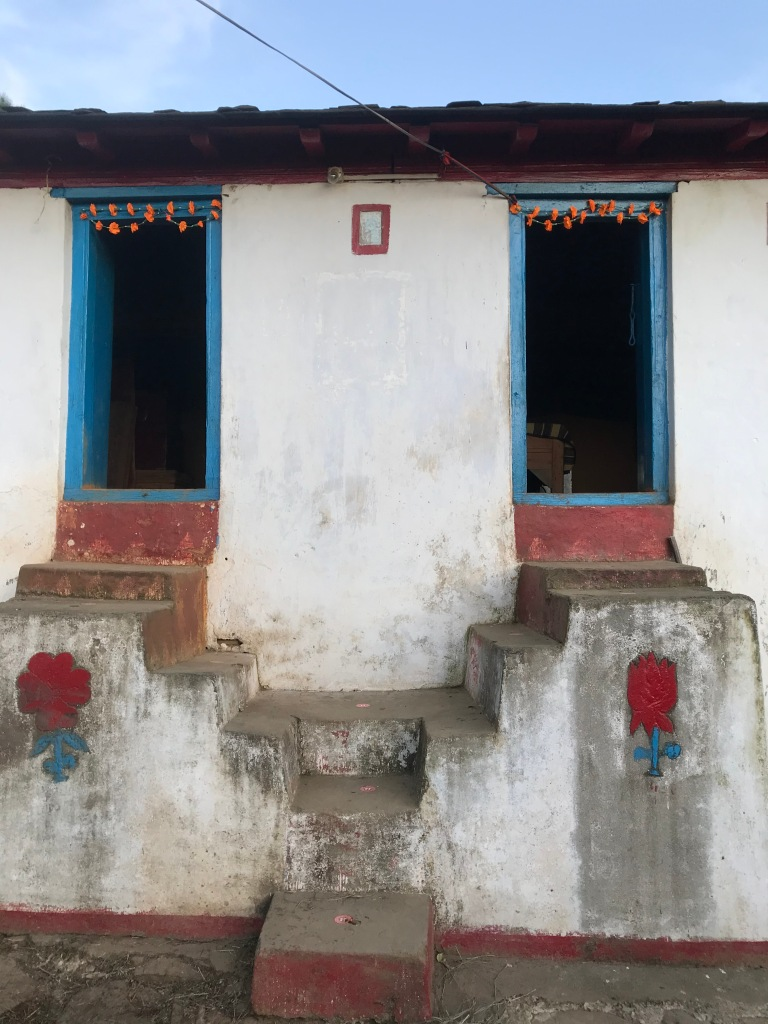 Brightly painted doors and windowsof village house